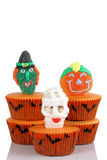 Scary cup cakes on white background. Scary monster cup cakes on white background royalty free stock photography