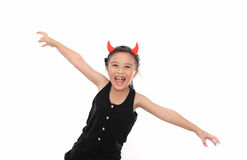 Scary cute little girl in black Halloween costume Stock Photos