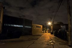 Scary dark city Chicago alley at night Stock Images