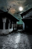 Scary dark courtyard in the ominous moonlight