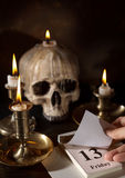 Scary date of Friday 13th. Friday 13th on a calendar with candles and a creepy skull stock images