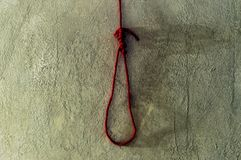 Scary and death concept with red rope noose for death on cement Stock Photos