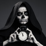 Scary Death Hold A Watch In His Hand. Realistic Skull Makeup Royalty Free Stock Photography