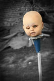 Scary doll. Scary old doll head on a stick Royalty Free Stock Photo