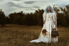 Scary evil clown in a bride dress Royalty Free Stock Photography