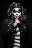 Scary evil clown girl. A scary evil clown girl with a wicked makeup Stock Images