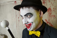 Scary evil clown wearing a bowler hat on wall Royalty Free Stock Photos