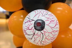 scary eye on white balloon. Halloween stock photo