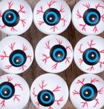 Scary eyeballs for Halloween season on rustic wood. En boards Stock Photos