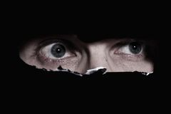 Scary eyes of a man spying Stock Images
