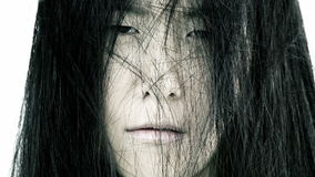 Scary face of asian woman like monster. Sad Chinese american woman with hair in face scary horror stock video footage