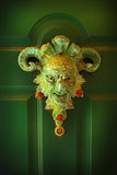 Scary face on a green door Stock Images