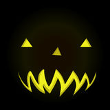 Scary face of Halloween pumpkin in dark background Stock Photo