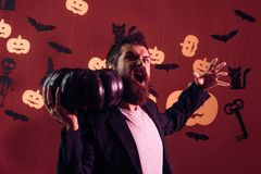 Scary face man with horror Make up holding Pumpkin head jack lantern on sky background. Wizard, sorcerer, warlock. Man on the Horror background. Halloween Witch stock image