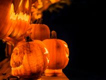 The scary face of the orange pumpkins with the light growing ins Royalty Free Stock Photo