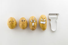 Potatoes with scared cartoon faces Stock Photography