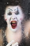 Scary face screaming mime. For murky glass royalty free stock images