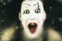 Scary face screaming mime. For murky glass stock photo