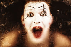 Scary face screaming mime. For murky glass royalty free stock photography