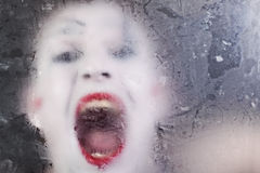 Scary face screaming mime for murky glass Royalty Free Stock Photography