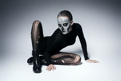 Scary fashionable woman posing on the floor. In studio Royalty Free Stock Photography