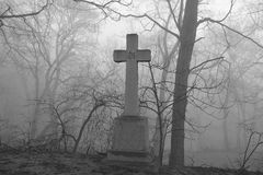 Scary foggy graveyard scene. Royalty Free Stock Photos