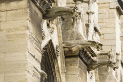Scary Gargoyles of Notre Dame, Paris, France. These scary gargoyles are supposed to scare away evil/bad spirits, but in reality, they are simply water spouts Royalty Free Stock Photos