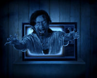 Scary ghost out from old television. Halloween concept Royalty Free Stock Images