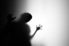 Scary girl. Scary hands on a white paper with backlight stock photo