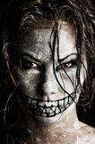 Scary girl. A scary looking girl with face paint Stock Photography