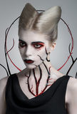 Scary girl with bloody body art Stock Photos