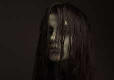 Scary girl. Close up horror portrait of a scary girl possessed. Zombie make up Stock Images