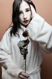 Scary girl. Go to sleep, white skin, dry rose Stock Image