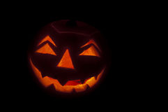 Scary glowing halloween face. Pumpkin lantern glowing in the dark royalty free stock photos