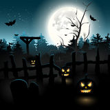 Scary graveyard and pumpkins Stock Images