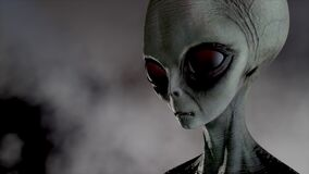Scary gray alien stands and looks blinking on a dark smoky background. UFO futuristic concept. 3D rendering.