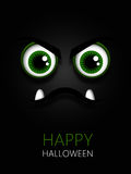 Scary green eyes with halloween wishes Stock Photos