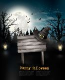 Scary Halloween background with a wooden sign. Royalty Free Stock Photography