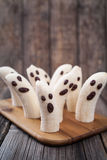 Scary halloween banana ghost chocolate faces Royalty Free Stock Photo