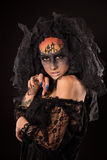 Scary Halloween Bride with Concept Scary Makeup. Halloween devil's bride. Portrait of young woman in dark artistic image with scary makeup, veil and terrible Stock Photos