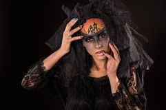 Scary Halloween Bride with Concept Scary Makeup. Halloween devil's bride. Portrait of young woman in dark artistic image with scary makeup, veil and terrible Royalty Free Stock Images