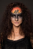 Scary Halloween Bride with Concept Scary Makeup. Halloween devil's bride. Portrait of young woman in dark artistic image with scary makeup, veil and terrible Stock Photography