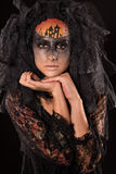 Scary Halloween Bride with Concept Scary Makeup. Halloween devil's bride. Portrait of young woman in dark artistic image with scary makeup, veil and terrible Stock Photo