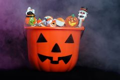 Scary halloween candy in pumpkin with smoke Royalty Free Stock Photography