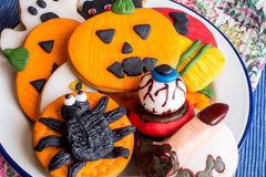 Scary halloween cookies on plate Royalty Free Stock Images