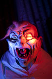 Scary Halloween Creature. Scary Halloween ghoul in haunted house with colored light Stock Image