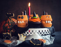 Scary Halloween cup cakes. Served on the table,selective focus Royalty Free Stock Photos