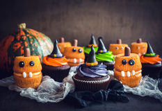 Scary Halloween cup cakes. On the table,selective focus Stock Images
