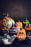 Scary Halloween cup cakes. On wooden background with blank space for text Stock Photography