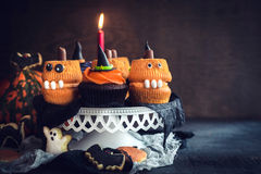 Scary Halloween cup cakes. Served on the table with blank space Royalty Free Stock Image